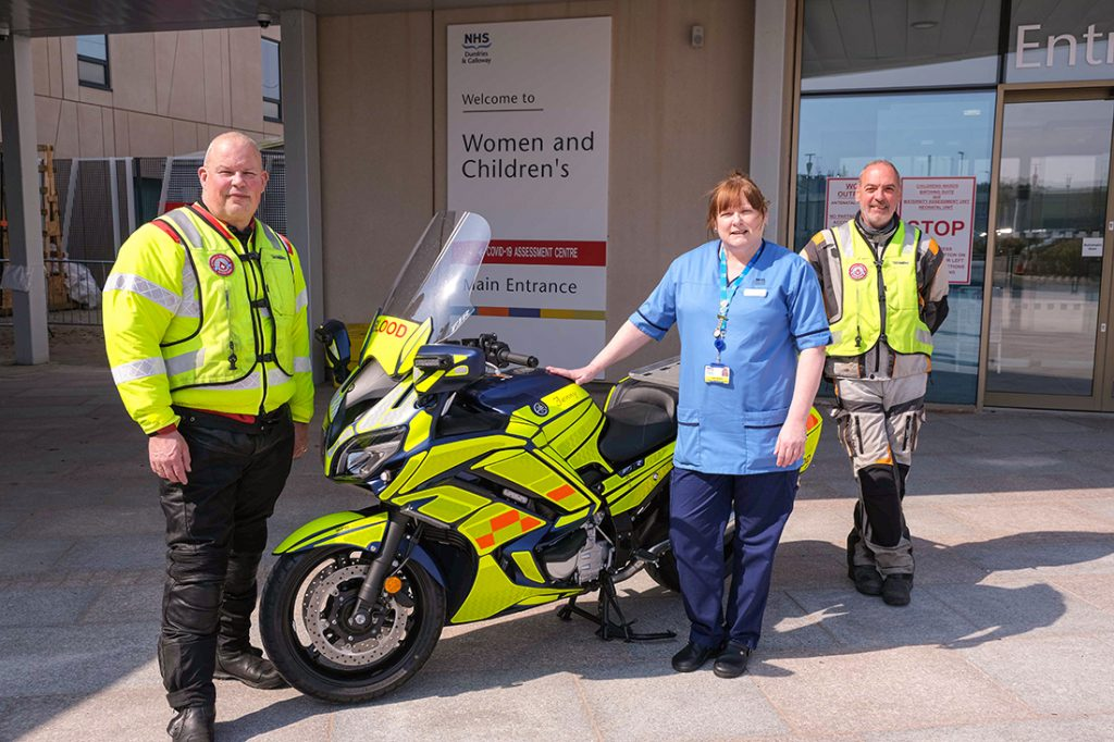 Dave Hook, chairman of Dumfries and Galloway Blood Bikes, Jenny Manson, and Bob Morrison.