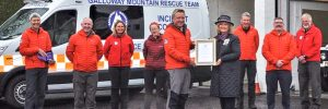 The Lord Lieutenant of Wigtown, Aileen Brewis presents the Queen's Award for Voluntary Service to Galloway Mountain Rescue.