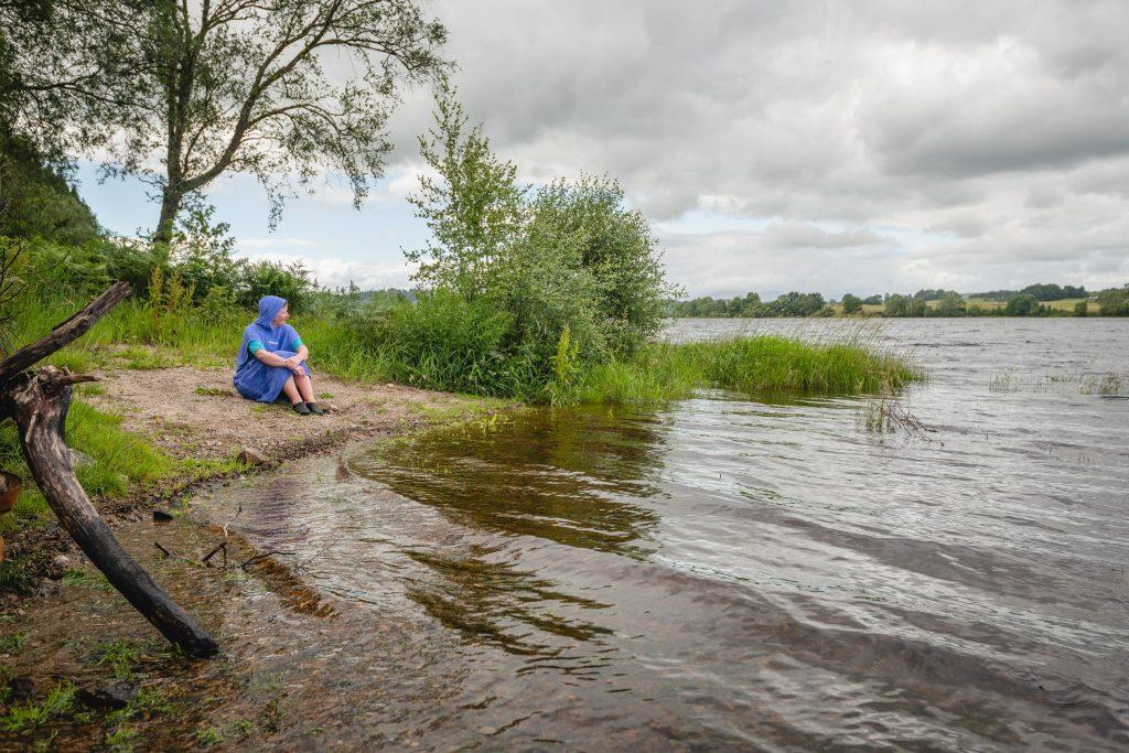 A wild swimmer steels herself before the plunge into Loch Ken.